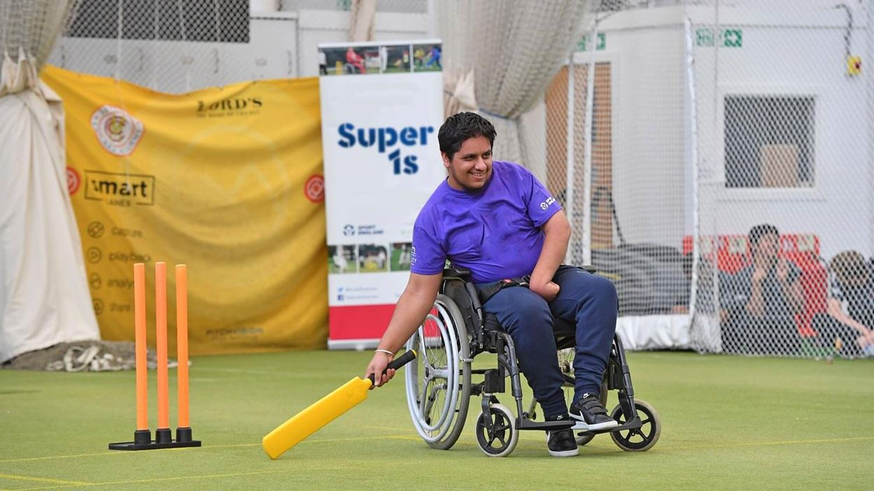 Player in a wheelchair playing cricket