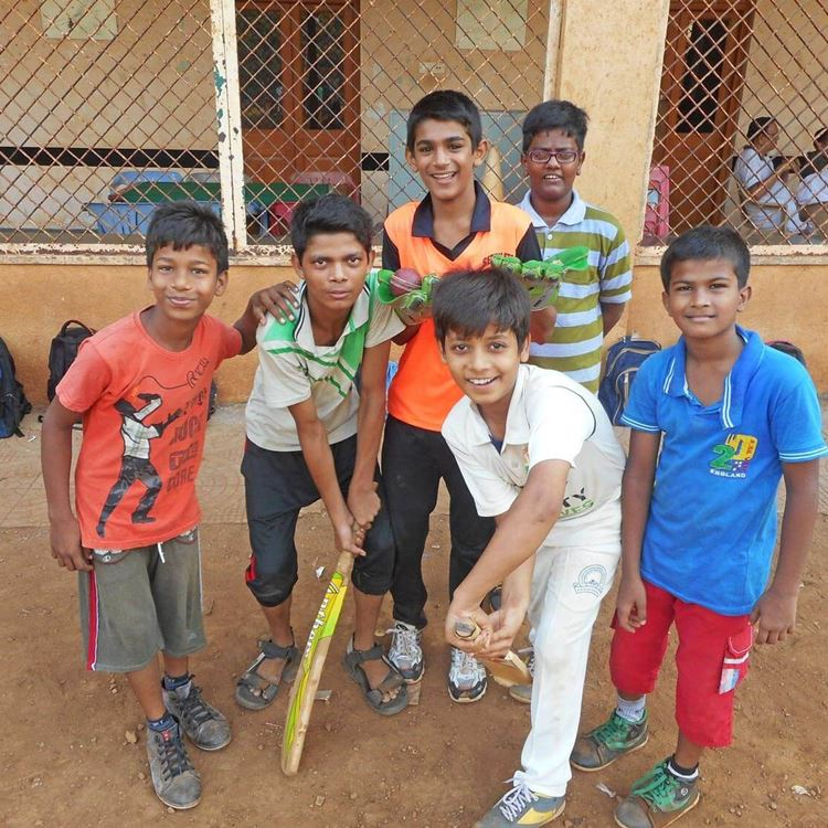 Group of young boys pretending to hit a ball