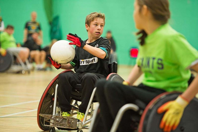 Boy about to pass the ball in wheelchair rugby