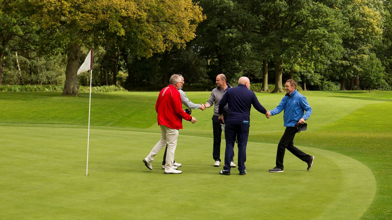 Handshakes all round at the final hole.jpg